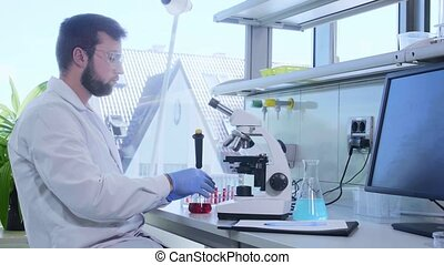 Scientist working in lab. Doctor making microbiology ...