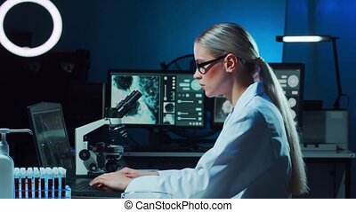 Scientist working in lab. Female doctor making medical ...