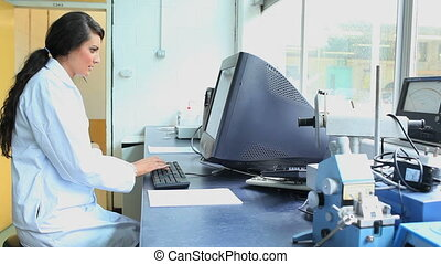 Scientist working with a computer in a laboratory