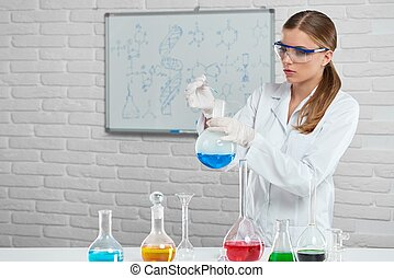 Scientist works with the chemical liquids