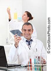 Scientists conducting experiments