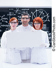 scientists in chemistry lab