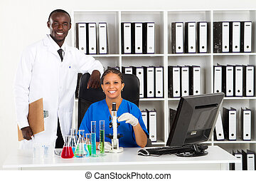 scientists in lab - two african american scientists in lab