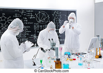 scientists laboratory analysis - general-view of three...