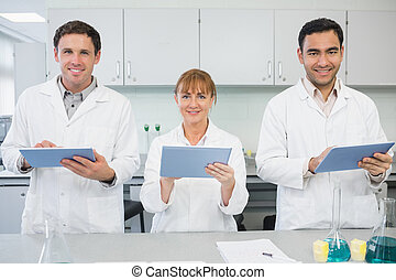 Scientists using tablet PCs in the lab