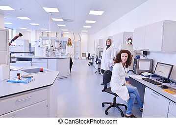 scientists working at the laboratory - group of scientists...