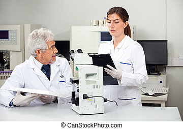 Scientists Working In Medical Laboratory