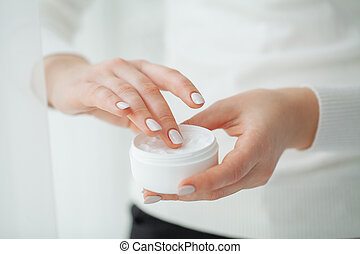 Scin care. Beautiful woman hands with cream
