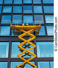 Scissor Lift Office Block - Workers On A Scissor Lift ...
