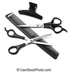 scissors and comb on white background