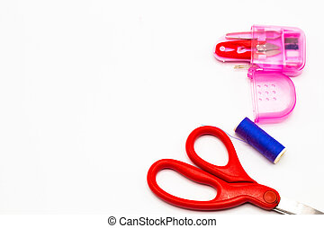 Scissors and office equipment on board background, education and back to school concept,Clipping path