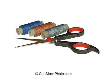 Scissors and spool of thread