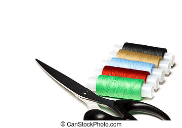 Scissors and thread on white background