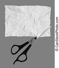 Scissors cut paper on a gray background