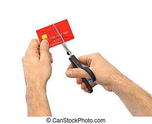 Scissors cutting old credit card