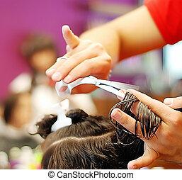 Scissors in hair dress work - Hands holding scissors cutting...