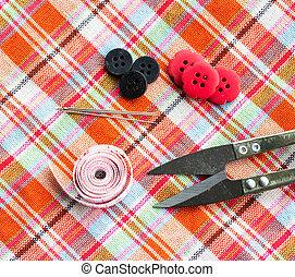 scissors, thread and needle to coar