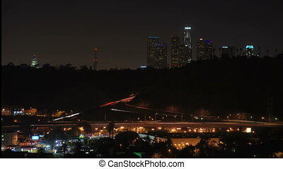 This is a timelapse shot of downtown Los Angeles and the 110 freeway from Highland Park.