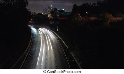 This is a time lapse shot of the 110 freeway looking at downtown Los Angeles in the background