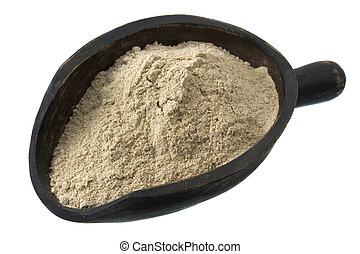 scoop of buckwheat flour - gluten free buckwheat flour on a...