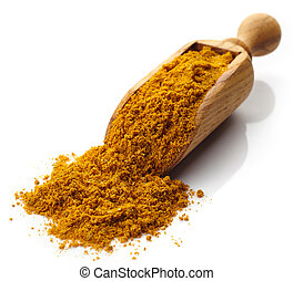 Scoop of curry powder - Wooden scoop of curry powder...