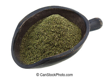 scoop of dried dill weed - dried dill weed on a rustic ...