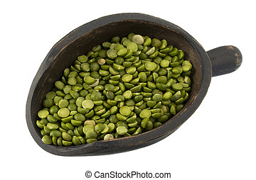 green split peas on a primitive, wooden scoop isolated on white
