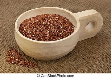 scoop of red quinoa