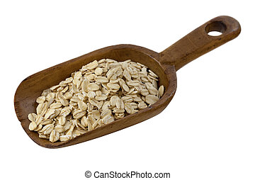 scoop of rolled oats - rolled oats on a rustic wooden scoop ...