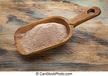 scoop of teff flour - whole grain teff flour from an ancient...