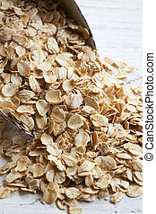 Scoop ofRolled Oats - Scoop of rolled oats, on weathered...