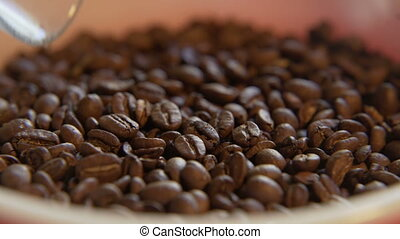Scooped Coffee Beans - Macro close up of beans getting...
