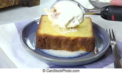 Scooping ice cream onto cake - Scooping ice cream onto a...
