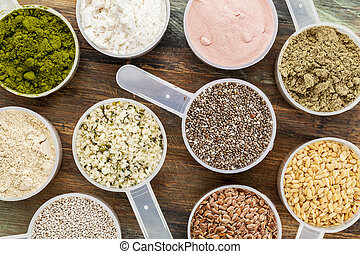 scoops of superfood - healthy seeds and powders (white and ...