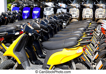 scooter bikes in rental shop in a row arrangement