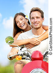 Scooter driving happy young couple fun in love