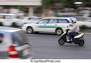 Scooter in traffic