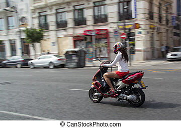 Scooter - VALENCIA, SPAIN - JUNE 10, 2014: A woman on a...