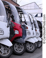 Scooters in a row in a front of motor-service shop.