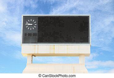 score board at football stadium with bluesky