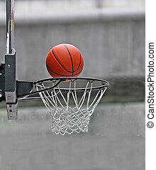Score! - Close up of a basketball falling into a hoop