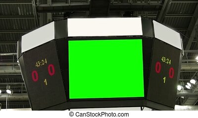 Green screen at the stadium scoreboard. Countdown to the start of a hockey game. The scoreboard at the top of the white banners.