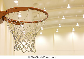 scoring basket in basketball court