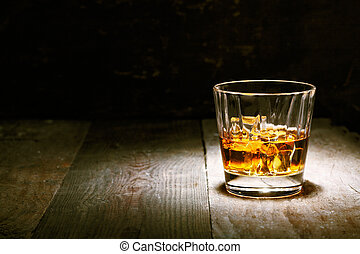 Scotch on wooden background with copyspace. An old and ...