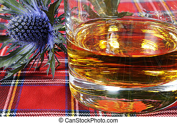 Scotch Whiskey and Thistle - Scotch whiskey and thistle on a...