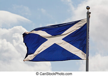 scotland flag on flagpole - the blue and white cross of st...