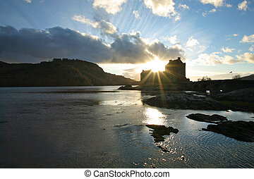 Scotland's iconic Eilean Donan Castle, on the way to Isle of Skye in the Outer Hebrides, seen at sunset