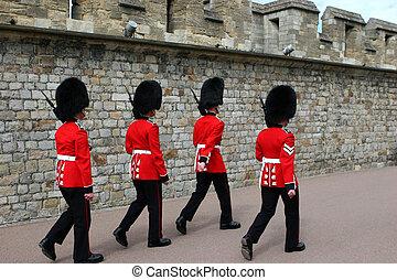 scots guards - the queens famous scots guardsmen marching