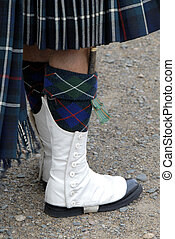 Scots Piper - Foot Detail Of A Scottish Soldier In...