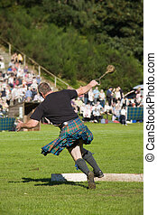 """Scotsman throwing the weight at a Highland Games event - """"..."""